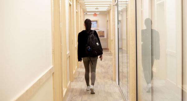 Student walking down a hall